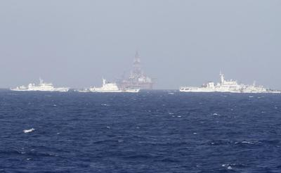 China says will never send military to oil rig spat...