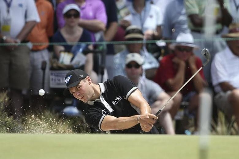 Jun 13, 2014; Pinehurst, NC, USA; Martin Kaymer hits from the bunker on the 6th hole during the second round of the 2014 U.S. Open golf tournament at Pinehurst Resort Country Club - #2 Course. Jason Getz-USA TODAY