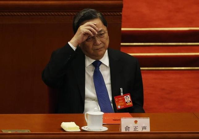 Yu Zhengsheng, Chairman of the Chinese People's Political Consultative Conference (CPPCC) National Committee gestures during the closing ceremony of the Chinese National People's Congress (NPC) at the Great Hall of the People, in Beijing, March 13, 2014. REUTERS/Kim Kyung-Hoon