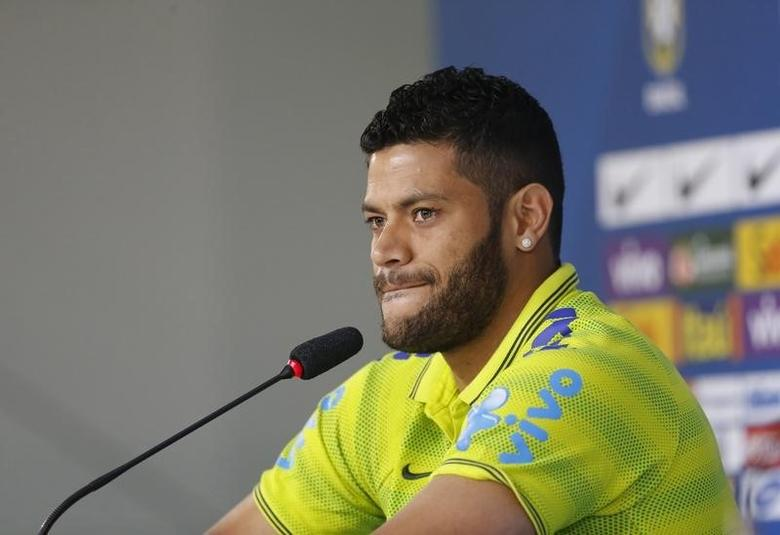 Brazil's player Hulk speaks during a news conference in Teresopolis June 15, 2014. REUTERS/Marcelo Regua