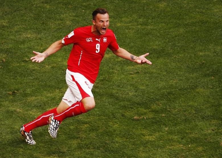 Switzerland's Haris Seferovic celebrates his goal against Ecuador during their 2014 World Cup Group E soccer match at the Brasilia national stadium in Brasilia June 15, 2014. REUTERS/David Gray\