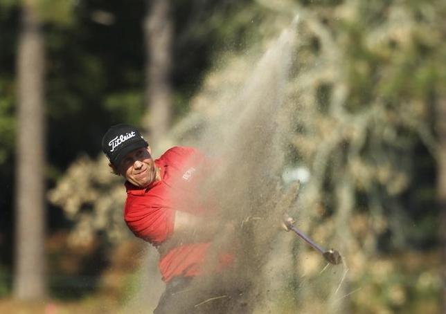 Erik Compton of the U.S. hits from the rough on the 11th hole during the final round of the U.S. Open Championship golf tournament in Pinehurst, North Carolina June 15, 2014. REUTERS/Robert Galbraith
