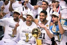 Jun 15, 2014; San Antonio, TX, USA; San Antonio Spurs forward Kawhi Leonard (2), guard Tony Parker (9), forward Tim Duncan (21) and guard Manu Ginobili (20) celebrate with the Larry O'Brian Trophy after game five of the 2014 NBA Finals at AT&T Center. Bob Donnan-USA TODAY Sports