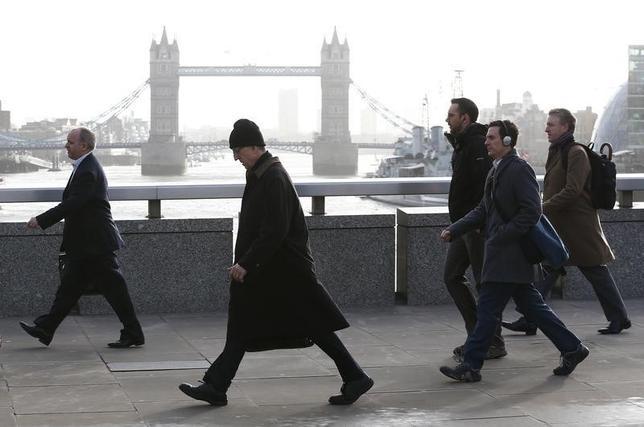 Tower Bridge is seen behind commuters as they walk across London Bridge during an Underground strike in London February 5, 2014. REUTERS/Eddie Keogh/Files