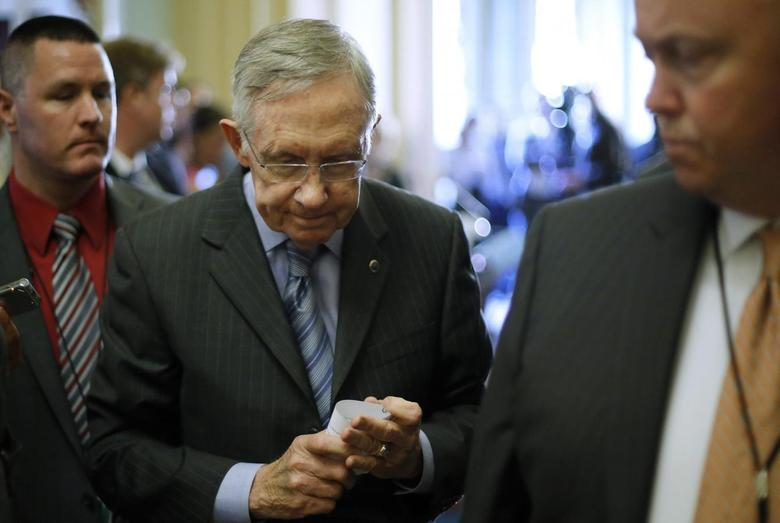 U.S. Senate Majority Leader Harry Reid (D-NV) departs after speaking to reporters following the weekly party caucus luncheon at the U.S. Capitol in Washington June 10, 2014. REUTERS/Jonathan Ernst