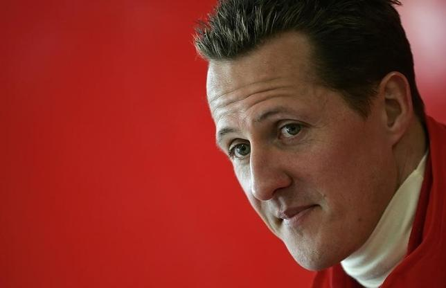 Michael Schumacher of Germany looks on during a news conference at the end of the official presentation of the new Ferrari Formula One race car 248 F1 at the Mugello racetrack in Scarperia, central Italy, January 24, 2006. REUTERS/Tony Gentile