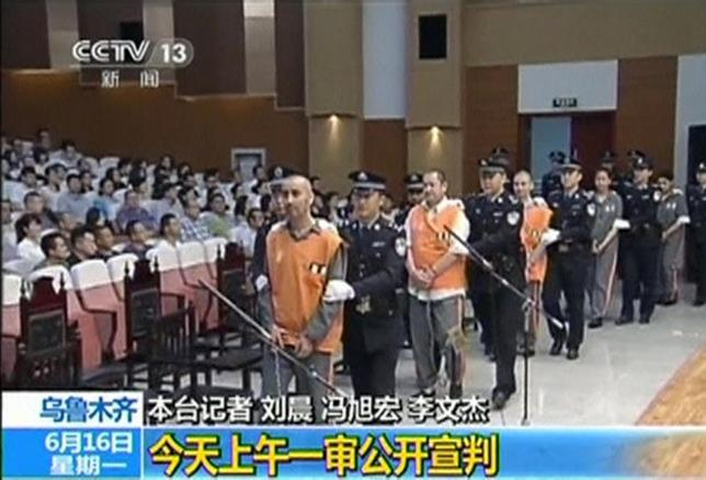 The trial of three people sentenced to death for their roles in an October attack on the edge of Beijing's Tiananmen Square is seen in this still image taken from video in Urumqi city, June 16, 2014.  REUTERS/CCTV/via Reuters TV