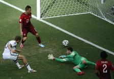 O alemão Thomas Mueller fez três gols na partida contra Portugal na estreia da Alemanha no Mundial. A Alemanha venceu por 4 x 0. REUTERS/Fabrizio Bensch