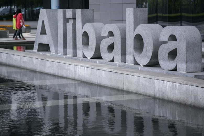 People walk at the headquarters of Alibaba in Hangzhou, Zhejiang province, April 23, 2014. REUTERS/Chance Chan