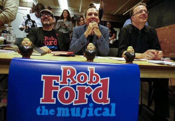 Writers P. Joseph Regan (L), Brett McCaig (C), and composer Anthony Bastinon watch auditions for ''Rob Ford The Musical: The Birth of a Ford Nation'' in Toronto, June 16, 2014. REUTERS/Mark Blinch