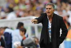 Técnico da seleção do Irã, Carlos Queiroz, durante partida contra Nigéria na Arena da Baixada, em Curitiba. 16/6/2014 REUTERS/Ivan Alvarado
