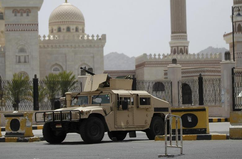 A military vehicle is stationed outside the al-Saleh mosque in Sanaa June 16, 2014. REUTERS/Khaled Abdullah