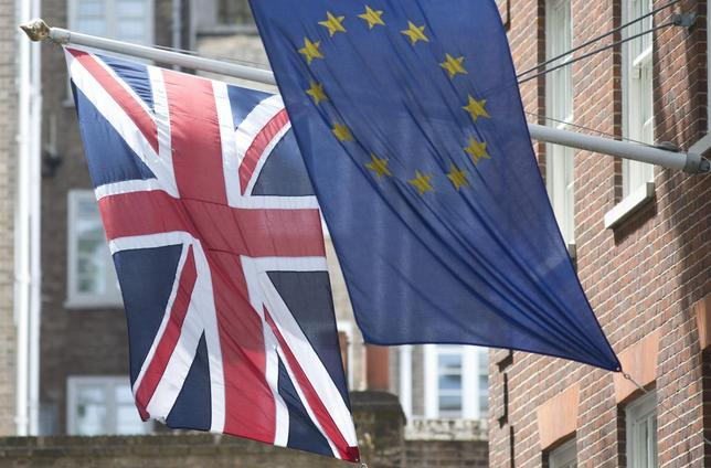 The Union Flag flies next to the European Flag outside the European Commission building in central London May 25, 2014.  REUTERS/Neil Hall
