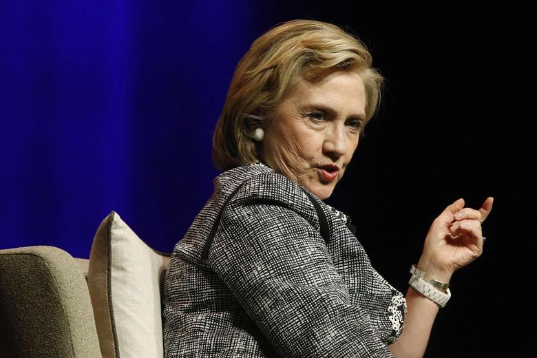 Former U.S. Secretary of State Hillary Clinton answers a question as she discusses her new book ''Hard Choices: A Memoir'' at George Washington University in Washington June 13, 2014.  REUTERS/Jonathan Ernst