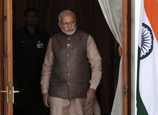 Prime Minister Narendra Modi comes out of a meeting room to receive his Bhutanese counterpart Tshering Tobgay before the start of their bilateral meeting in New Delhi May 27, 2014. REUTERS/Adnan Abidi/Files