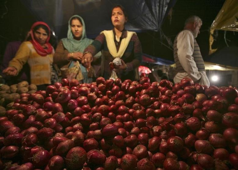 Customers purchase onions at a vegetable market in Jammu February 4, 2013. REUTERS/Mukesh Gupta