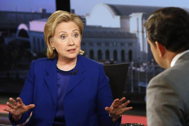 Former U.S. Secretary of State Hillary Clinton (L) sits for a live interview with Bret Baier at the FOX News Channel studio in Washington June 17, 2014.  REUTERS/Jonathan Ernst