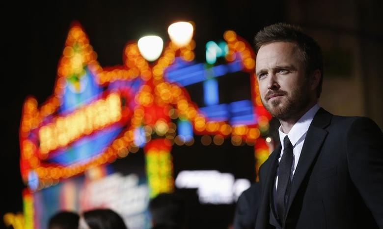 Aaron Paul poses at the premiere of the film ''Need for Speed'' at the TCL Chinese theatre in Hollywood, California March 6, 2014. REUTERS/Mario Anzuoni/Files