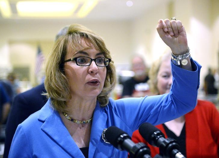 Former U.S. Rep. Gabrielle Giffords speaks to reporters during the New Eastcoast Arms Collectors Associates Arms Fair at the Saratoga Springs City Center in Saratoga Springs, New York, October 13, 2013. REUTERS/Hans Pennink