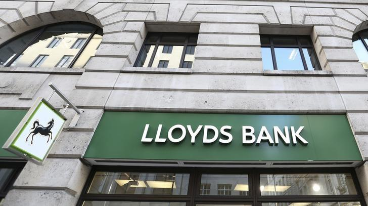 The signage is seen at a branch of Lloyds bank in central London February 13, 2014.   REUTERS/Paul Hackett