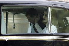 Queen Letizia (R) touches the cheek of Spain's new King Felipe VI as they sit in their car while leaving the Zarzuela Palace to the Congress of Deputies in Madrid, June 19, 2014. EFE/Zipi/Pool