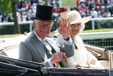 Prince Charles, the Prince of Wales and Duchess of Cornwall Camilla arrive for the second day of the Royal Ascot horse racing festival at Ascot, southern England June 18, 2014. REUTERS/Suzanne Plunkett