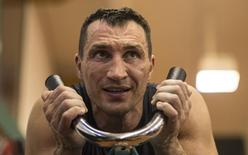 Ukrainian heavy weight boxing World Champion Wladimir Klitschko attends a public training session in Going April 8, 2014. REUTERS/Lukas Barth