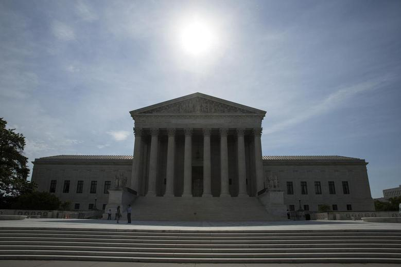 The sun rises over the Supreme Court in Washington June 19, 2014.  REUTERS/Joshua Roberts