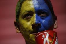 Болельщик сборной Эквадора перед матчем со Швейцарией в Бразилии 15 июня 2014 года.  Сборная Гондураса сыграет в ночь на субботу с Коста-Рикой в матче группы E чемпионата мира по футболу в Куритибе REUTERS/Ueslei Marcelino