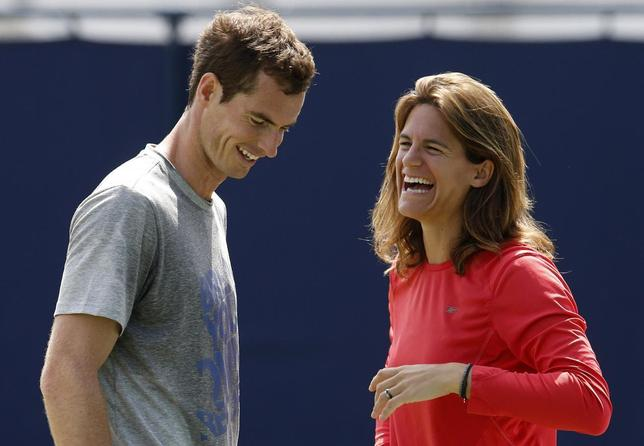 Britain's Andy Murray and his newly appointed coach Amelie Mauresmo react during a practice session at the Queen's Club Championships in west London June 12, 2014. REUTERS/Suzanne Plunkett