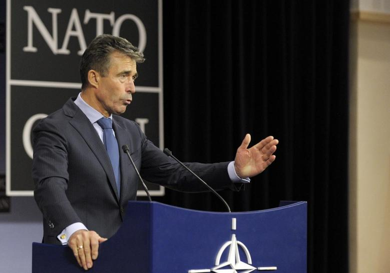 NATO Secretary General Anders Fogh Rasmussen addresses a news conference during a NATO defence ministers meeting at the Alliance headquarters in Brussels June 4, 2014.  REUTERS/Laurent Dubrule