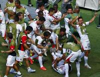 Costa Rica's players celebrate after their teammate Bryan Ruiz (on the ground) scored a goal against Italy during their 2014 World Cup Group D soccer match at the Pernambuco arena in Recife June 20, 2014. REUTERS/Ruben Sprich
