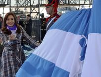 Argentine President Cristina Fernandez de Kirchner stands next to an Argentina flag during commemorations of the National Flag Day in Rosario June 20, 2014.  REUTERS/Argentine Presidency/Handout via Reuters