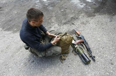 Fighting strains Ukraine ceasefire, Putin urges...