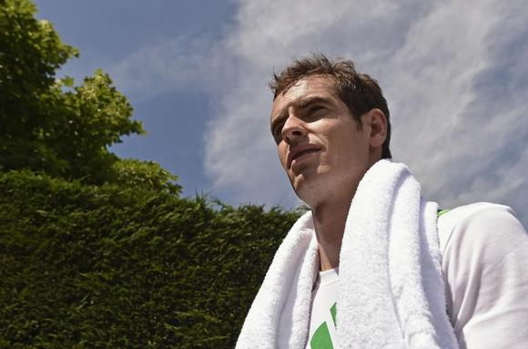 Andy Murray of Britain leaves following a training session ahead of the Wimbledon Tennis Championships in London June 22, 2014. REUTERS/Toby Melville