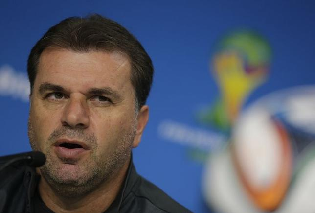 Australia's national soccer coach Ange Postecoglou attends a news conference at the Arena Baixada soccer stadium in Curitiba, June 22, 2014.  REUTERS/Henry Romero
