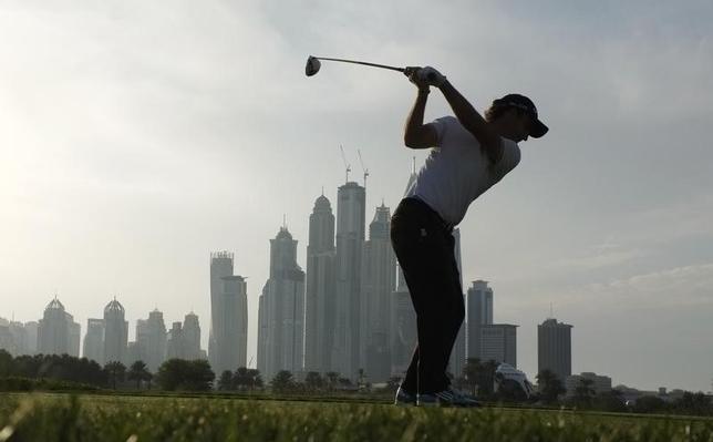 Edoardo Molinari from Italy takes his tee shot on the 8th hole during the first round of the 2014 Omega Dubai Desert Classic in Dubai January 30, 2014.  REUTERS/Caren Firouz