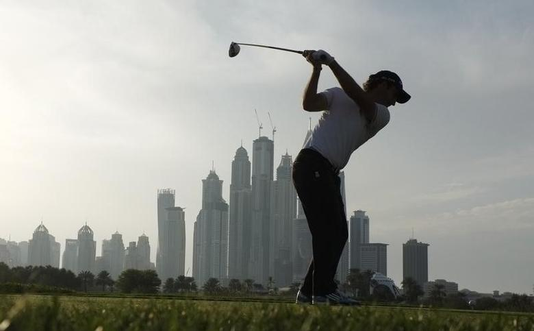 Edoardo Molinari from Italy takes his tee shot on the 8th hole during the first round of the 2014 Omega Dubai Desert Classic in Dubai January 30, 2014.  REUTERS/Caren Firouz