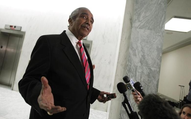 U.S. Representative Charlie Rangel (D-NY) gestures as he speaks to the members of the media in front of his House office on Capitol Hill in Washington, November 16, 2010. REUTERS/Hyungwon Kang
