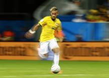 Neymar, da seleção brasileira, durante partida contra Camarões em Brasília. 23/06/2014. REUTERS/Dominic Ebenbichler