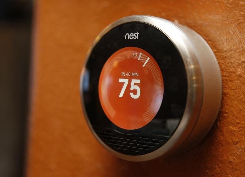 A Nest thermostat is installed in a home in Provo, Utah, January 15, 2014.  REUTERS/George Frey