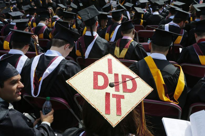 Graduating student Katherine Thomas has ''I Did It'' written on her mortar board during Commencement Exercises at Boston College in  Boston, Massachusetts May 19, 2014.    REUTERS/Brian Snyder