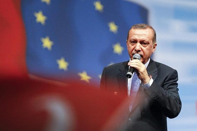 Turkey's Prime Minister Tayyip Erdogan stands on stage as he attends a political rally for members of the expatriate Turk community in Chassieu, near Lyon, June 21, 2014.  REUTERS/Emmanuel Foudrot