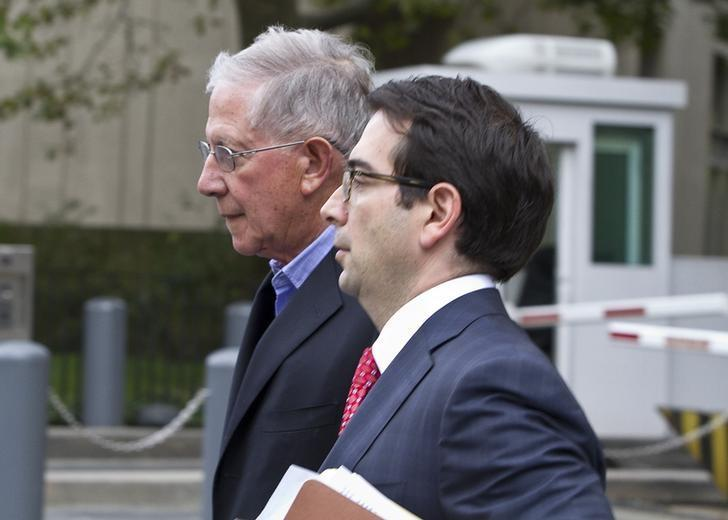 Paul Konigsberg (L), the former accountant and a former senior tax partner at Konigsberg Wolf & Co in New York, leaves the Manhattan federal courthouse after making bail, with his lawyer Reed Brodsky, in New York, September 26, 2013.   REUTERS/Zoran Milich