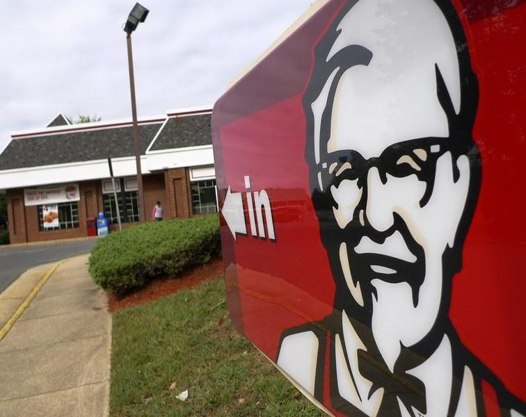 A Kentucky Fried Chicken sign shows the direction to its restaurant in Fairfax, Virginia October 5, 2010. REUTERS/Larry Downing