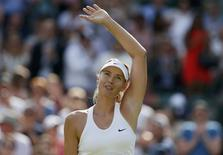 Maria Sharapova of Russia waves after defeating Samantha Murray of Britain in their women's singles tennis match at the Wimbledon Tennis Championships, in London June 24, 2014.             REUTERS/Stefan Wermuth