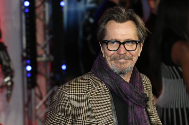 Cast member Gary Oldman poses for photographers as he arrives at the premiere of Robocop at the BFI IMAX Southbank in London in this February 5, 2014, file photo.  REUTERS/Suzanne Plunkett/Files