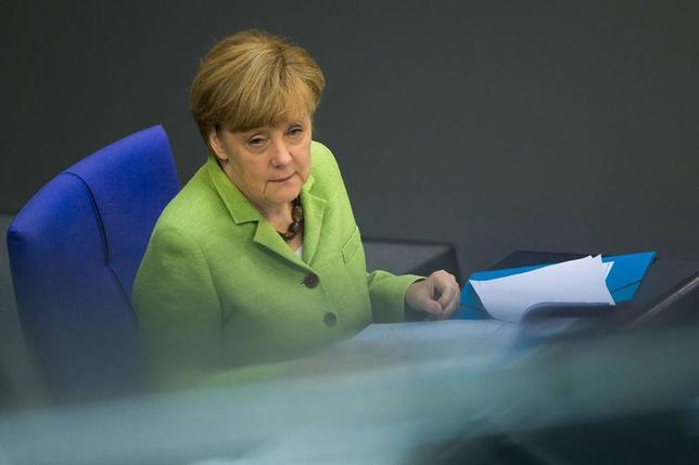 German Chancellor Angela Merkel attends a session of the lower house of parliament, the Bundestag, about the federal budget in Berlin, June 24, 2014.   REUTERS/Thomas Peter