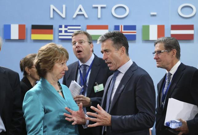 European Union foreign policy chief Catherine Ashton listens to NATO Secretary General Anders Fogh Rasmussen (R) during a NATO foreign ministers meeting at the Alliance headquarters in Brussels June 25, 2014. REUTERS/Francois Lenoir