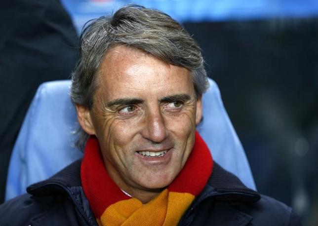 Galatasaray's coach Roberto Mancini smiles before their Champions League soccer match against Chelsea at Stamford Bridge in London March 18, 2014.      REUTERS/Eddie Keogh